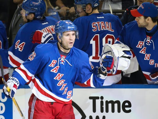 fbd18f9fd7d New York Rangers right wing Martin St. Louis (26) celebrates with New York