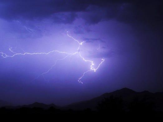 Lightning fills  the sky outside of Maricopa on August 17, 2014.