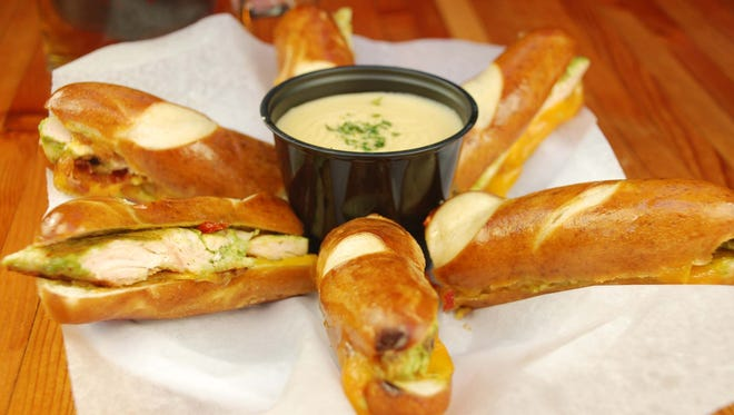 Handlebar Tempe transforms their pretzel rods into a stuffed chicken, cheddar and bacon sandwich for a heartier appetizer.