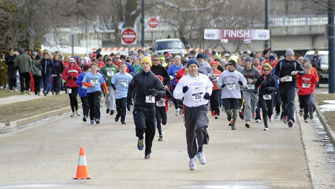 Hundreds of runners set out for the start of the  annual Run the Rapids 5K.