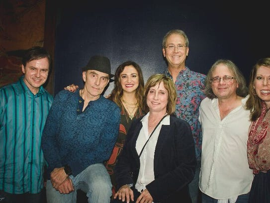 The band Remedy -- shown here with representatives from InterFaith Health Clinic -- will represent InterFaith Friday in the 11th annual Doc Rock battle of the bands at the International. From left are Jeff Smithers, Dr. Marty Prince, nurse practitioner Samantha Pernell, Dr. Mark Jackson and Dr. Mike Flowers.