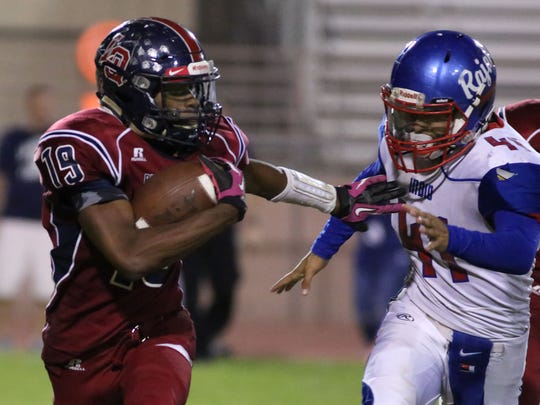 La Quinta's Derrick Kennedy gains yards against Indio in the first quarter on Friday, October 27, 2017 in La Quinta.