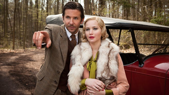 "George Pemberton (Bradley Cooper) and his bride, Serena (Jennifer Lawrence), carve an empire out of the North Carolina woods in ""Serena."""