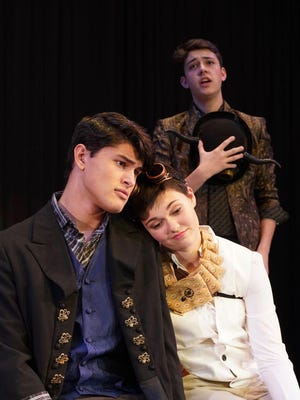 """""""In Larry A. Ryle's 'Twelfth Night,' Duke Orsino (Evan Bales) and Cesario/Viola (Averie Morris) share an awkwardly romantic moment during the Fool's song. Orsino does not know why, but he is falling for his servant, Cesario."""""""