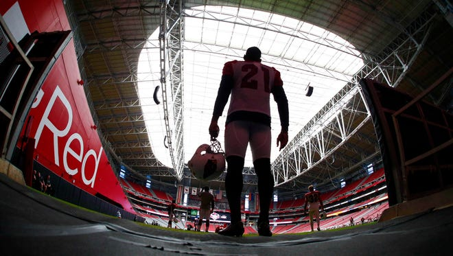 Arizona Cardinals cornerback Patrick Peterson arrives on the field for training camp in Glendale.