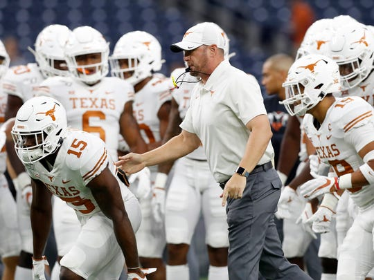 HOUSTON, TX - SEPTEMBER 14:  Head coach Tom Herman of the Texas Longhorns watches players warm up before the game against the Rice Owls at NRG Stadium on September 14, 2019 in Houston, Texas.  (Photo by Tim Warner/Getty Images)
