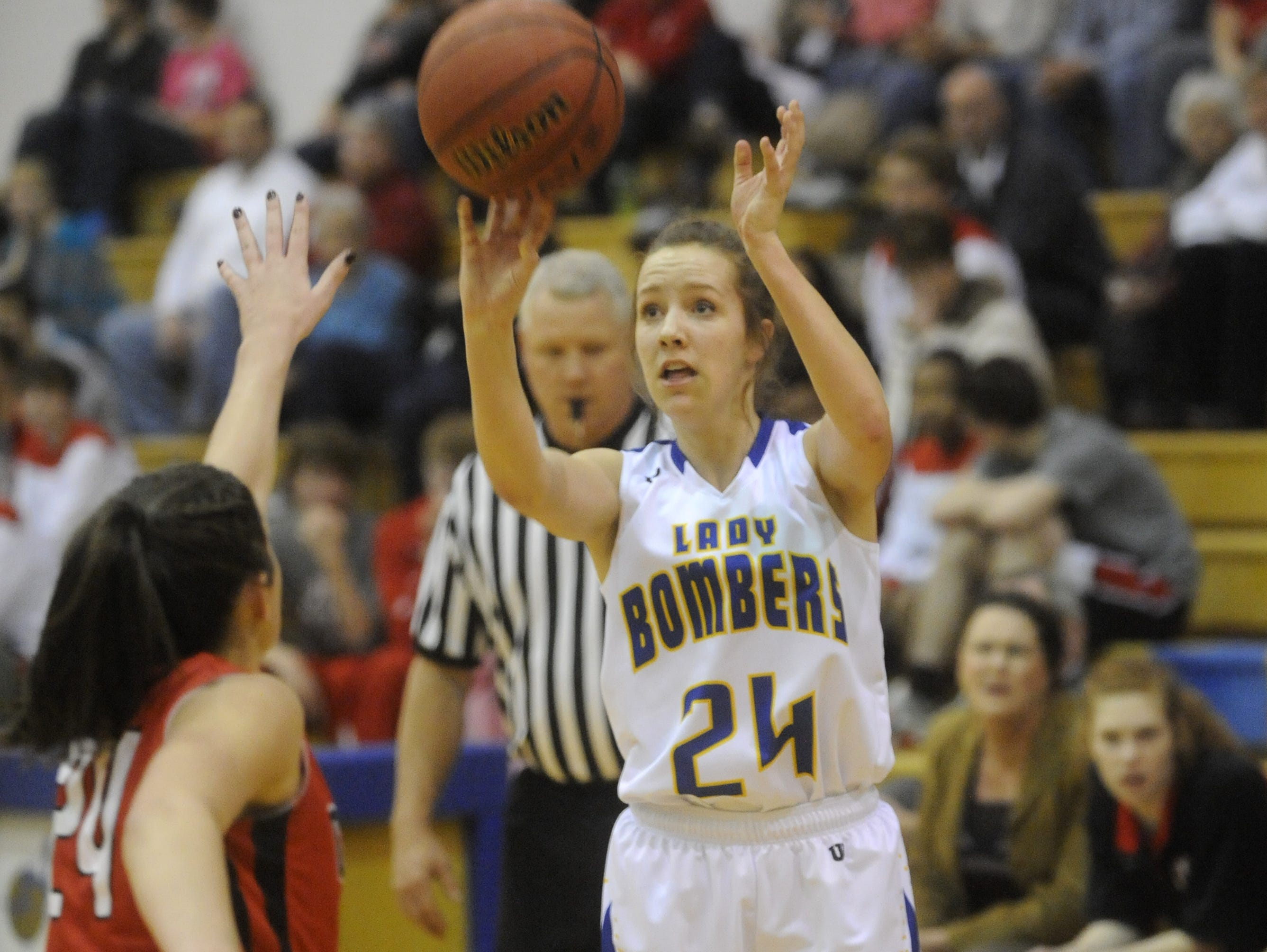 Mountain Home's Cassie Martin puts up a shot during a game last season against Cabot. Martin returns for her third season at guard for the Lady Bombers.