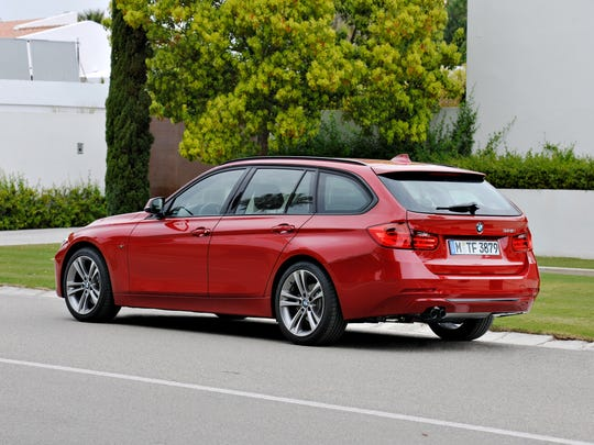 The 2014 BMW 328d xDrive Sports Wagon adds athletic attitude with a wide stance grounded by 18-inch alloys with low-profile tires.