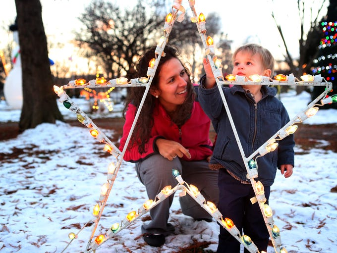 Stasia Lindsey, left, looks at holiday lights with her son Joseph, 2, at Brown Park in St. Matthews. Dec. 11, 2013.