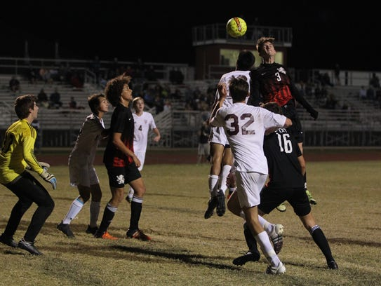 Leon's Tanner Powell heads a goal