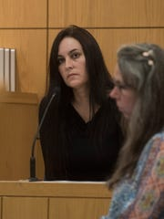 Ashley McArthur left, gives testimony during bond revocation