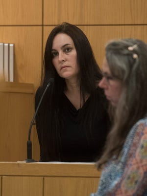 Ashley McArthur left, gives testimony during bond revocation hearing before Circuit Judge Jan Shackelford Monday, April 23, 2018. McArthur is accused of killing private detective Taylor Wright and burying her on a family member's property.