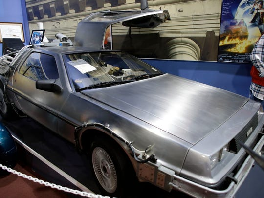 "This Dec. 24, 2013 photo shows the 1982 Delorean ""Time Machine"" from the movie ""Back to the Future"" displayed at the Dezer Collection Museum in North Miami, Florida."