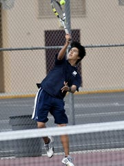 Redwood's John Nguyen serves to Mt. Whitney's Aaron