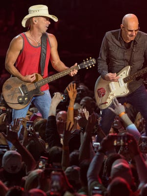 Kenny Chesney, left, shown performing at Miller Park in 2018, will return to the Milwaukee Brewers' stadium for a show April 25.