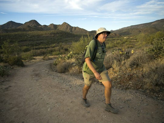 Jon Wienand of Cave Creek, hikes along the Spur Cross Trail in the Spur Cross Ranch Conservation Area outside of Cave Creek on November 14, 2017.