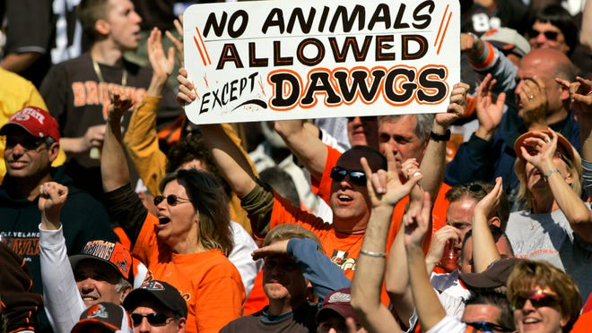 """In this Sunday, Sept. 16, 2007 file photo, fans in the Dawg Pound at Cleveland Browns Stadium whoop it up during the Browns' 51-45 win over the Cincinnati Bengals in an NFL football game in Cleveland. Joe Horrigan calls it a """"many decades love affair with football."""" Readers of his book, """"NFL Century,"""" will call it masterful. """"Dawg Pound Radio"""" is about to debut on SiriusXM, hosted by Bernie Kosar and longtime voice of the Cleveland Browns Jim Donovan. (AP Photo/Amy Sancetta, File)"""