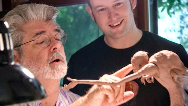 "George Lucas and sculptor Darren Marshall finesse the final design of the Bog King (voiced by Alan Cumming) for the animated motion picture ""Strange Magic."""