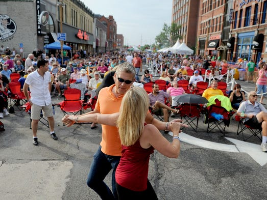 Lisa Lockwood and Don Neu dance during a performance of the Chris Hawkey Band at the Takin' It To The Streets festival. The event took place  near Pioneer Place on Fifth on Saturday and included music and food from local businesses.