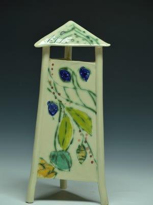 A whitestone birdhouse by artist Shirley Knudsvig.