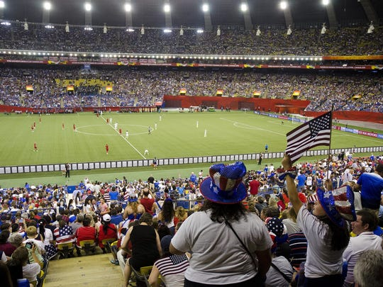 A pro-United States crowd cheers before the first kick of the second half of Tuesday's Women's World Cup semifinal between the U.S. and Germany at Olympic Stadium in Montreal, Canada.