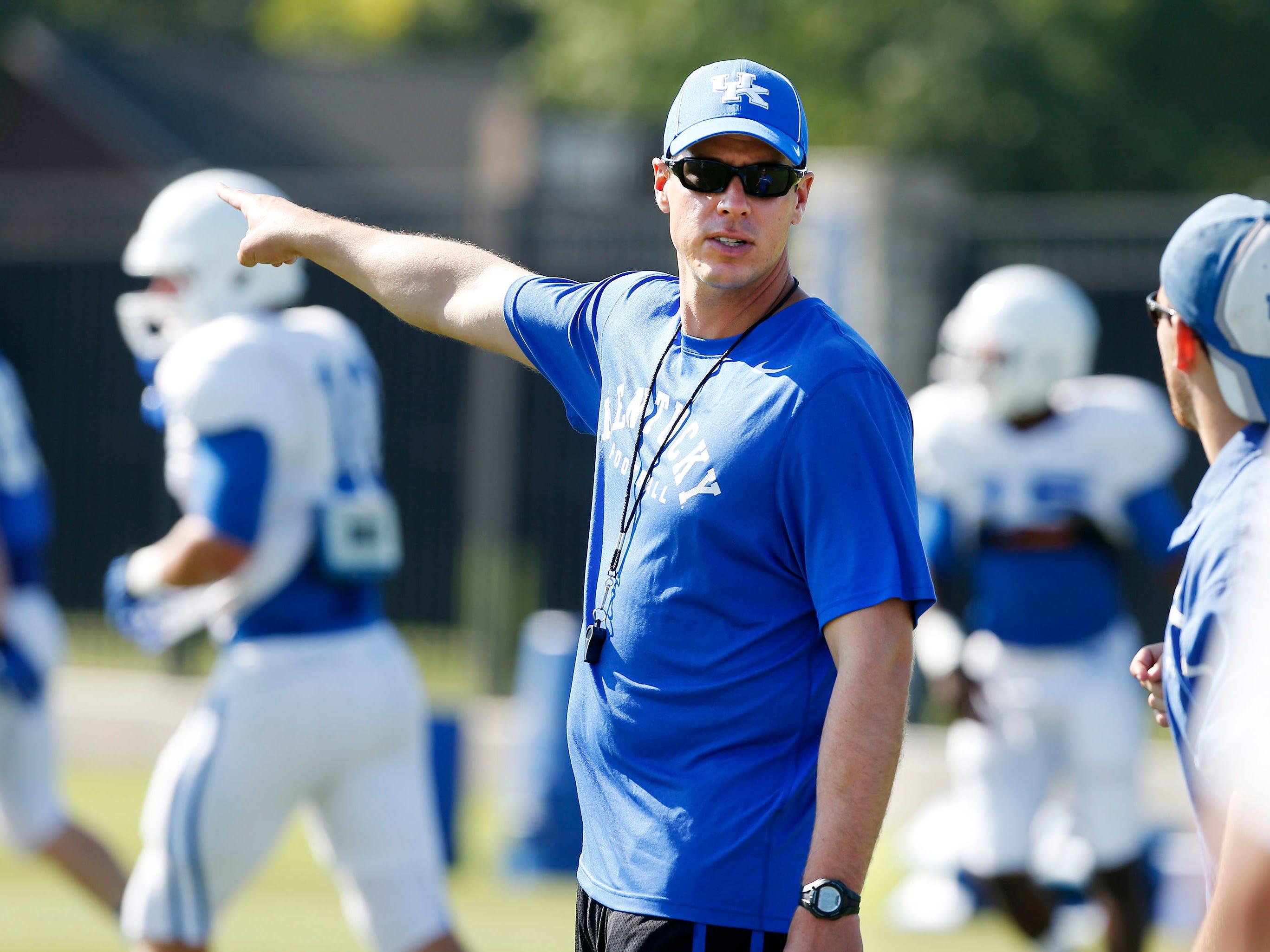 Defensive coordinator/linebackers coach D.J. Eliot gave instruction during Kentucky football practice in Lexington, Ky. Aug. 24, 2013