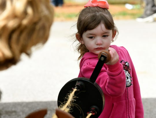 Imani Webster, 4, of Mt. Vernon twists twine into rope