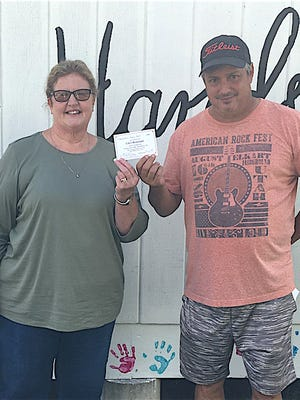 Cibo's Owner Jim Fragasse presents a gift certificate to Director Becky Larson of Helping Hands. Fragasse partners with State Farm Insurance to provide Cibo's gift certificates to families impacted by the COVID-19 pandemic.