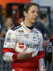 Brad Keselowski, driver of the No. 2 Wurth Ford, stands on the grid during qualifying for the NASCAR Sprint Cup Bank of America 500 on Oct. 6, 2016, in Charlotte, N.C.
