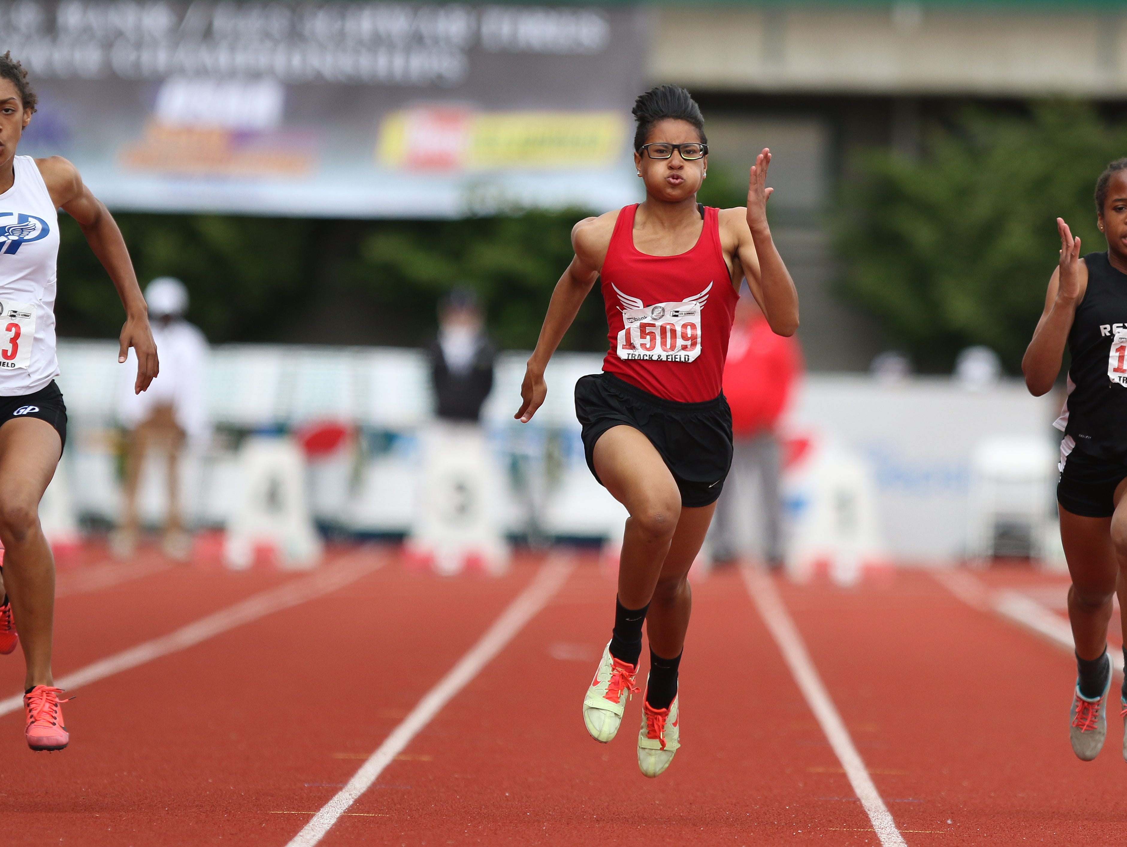 North Salem's Rebekah Miller (center) won the 6A state championship in the 100-meter dash last season, but the Vikings have struggled in most of the OSAA-designated team sports.