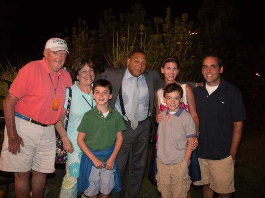 Float-ors founder Hughie McBride poses for a picture with his family and Wynton Marsalis (center) in 2014.