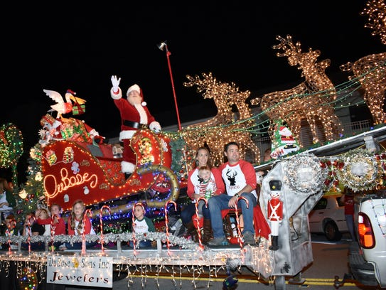 Santa Claus is perched atop the Dubose & Sons Jewelers float at a recent Vero Beach Christmas parade.