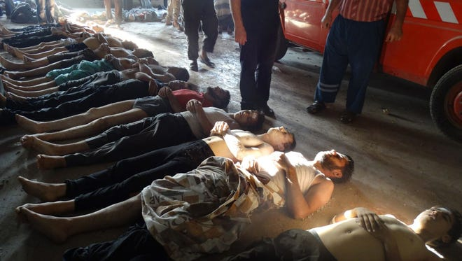 This image provided by Shaam News Network on Thursday, Aug. 22, 2013, which has been authenticated based on its contents and other AP reporting, purports to show bodies of victims of an attack on Ghouta, Syria on Wednesday, Aug. 21, 2013.