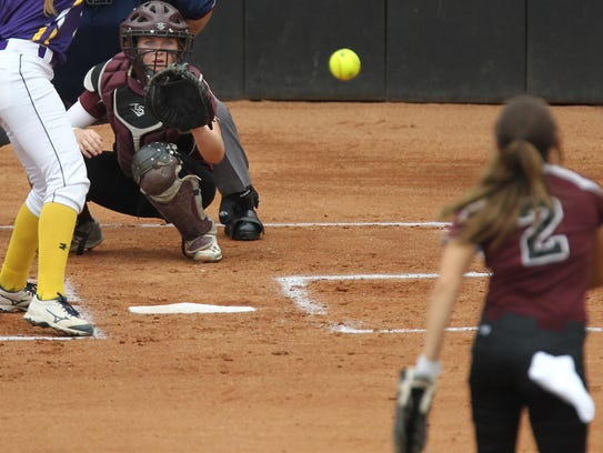 Vernon's Lauren Hager catches a pitch from Jade Guzman during last year's Class 4A state tournament. Hager calls all the pitches for Guzman and freshman pitcher Shay Williams.