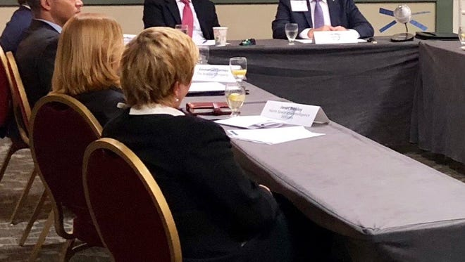 Republican gubernatorial candidate Adam Putnam, center, participated Wednesday in a roundtable discussion with aerospace officials in Melbourne.
