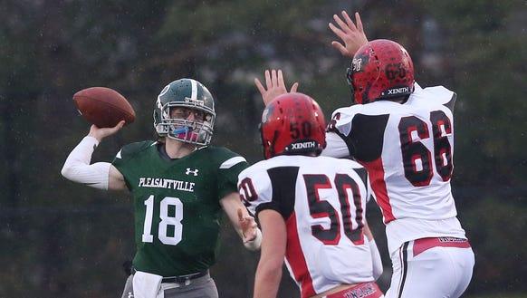 Pleasantville quarterback Jack Howe (18) passes while