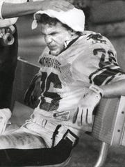 MSU's Blake Ezor haas his head rubbed down late in a Gator Bowl loss to Georgia on New Year's night 1989.