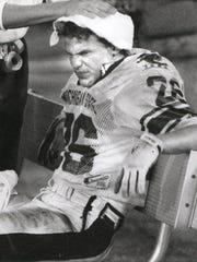 MSU's Blake Ezor haas his head rubbed down late in a Gator Bowl loss to Georgia on New Year's night 1989.