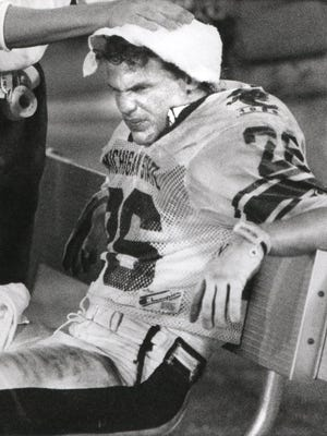 Blake Ezor has his head rubbed down late in a Gator Bowl loss to Georgia on New Year's night 1989,