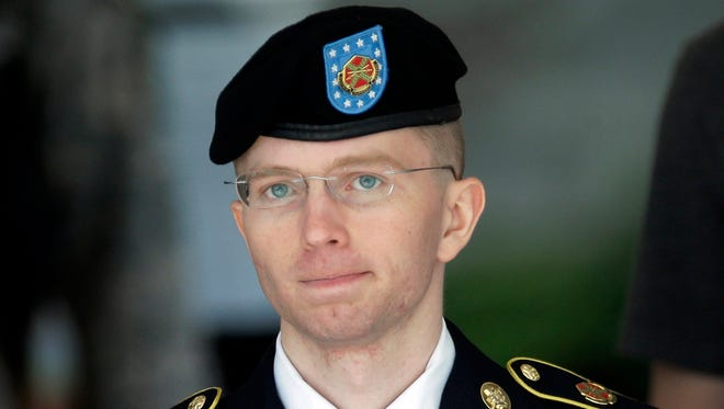 In this June 5, 2013, file photo Army Pvt. Chelsea Manning, then-Army Pfc. Bradley Manning, is escorted out of a courthouse in Fort Meade, Md., during court martial proceedings. Manning is serving a 35-year sentence for leaking documents.