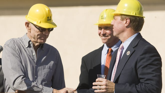 John Wessman, left, shakes the hand of Palm Springs Mayor Steve Pougnet during the symbolic demolition of the mall in downtown Palm Springs on February 7, 2013.