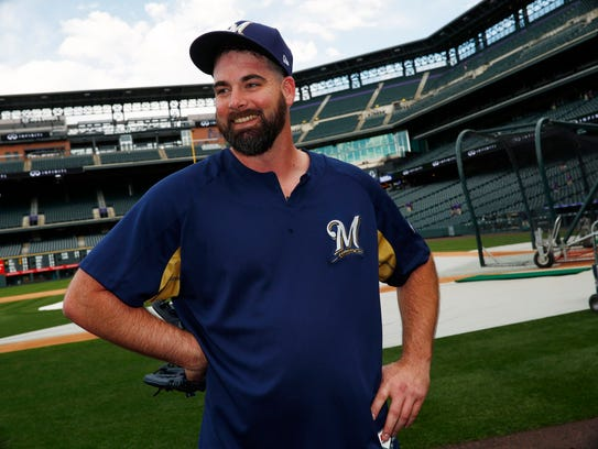 Brewers relief pitcher Boone Logan jokes with members