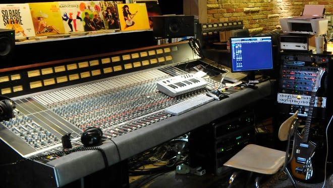 A sound board in a Nashville home studio
