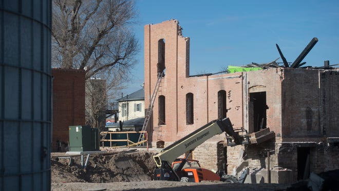 An idle construction site surrounds the Windsor Mill earlier this month. The mill was destroyed by a fire in August.