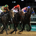 Embellishing Bob (center) with Brian J. Hernandez, Jr. aboard, wins the 90th running of the Derby Trial on opening day of Churchill Downs on Saturday. Second place is Bayern (right) with Rosie Napravnik aboard and third place was Myositis Dan (left) with Joseph Rocco, Jr. aboard. April 26, 2014