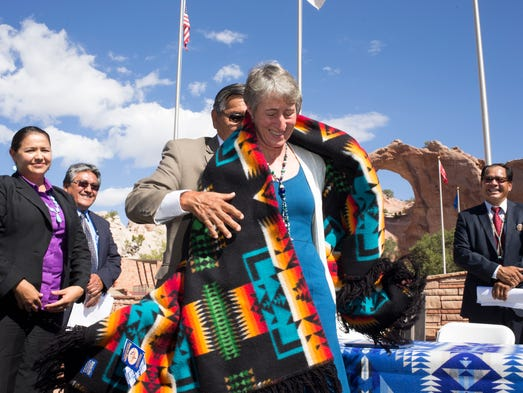Navajo Nation President Ben Shelly presents Secretary of the Interior Sally Jewell with a blanket after signing the $554 million settlement on Sept. 26, 2014, at Window Rock Veterans Memorial Park in Window Rock.