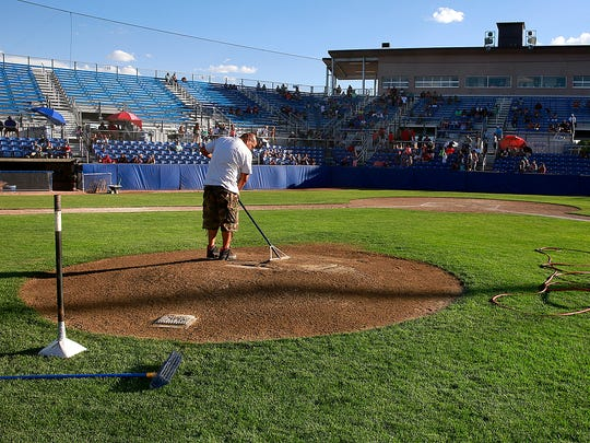 Leland Neswood prepares the field for a Connie Mack City Tournament game on July 16 at Ricketts Park.