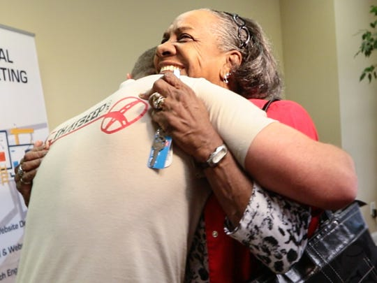 John Gurley, left, of Anderson, gets a hug from Doris Baskin, right, of Anderson, moments after he met her for the first time in Anderson. Gurley, who looks for silver and gold treasures with his metal detector wherever he gets permission to search, found her lost 1964 Westside High School class ring. Baskins said she lost the ring 52 years ago on the grounds of the Anderson Country Club.