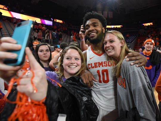 Clemson guard Gabe DeVoe (10) celebrates with students