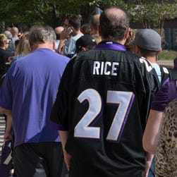 Ravens fans wait in line to exchange their Ray Rice jerseys on Friday.